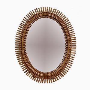 Espejo de pared italiano oval de ratán, años 60
