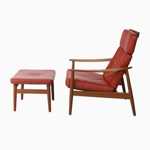 Mid-Century Armlehnstuhl des Modells 164 aus Leder mit Fußocker von Arne Vodder für France & Son