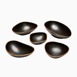 Cuencos decorativos Pebbles de bronce y oro de Reda Amalou. Juego de 5