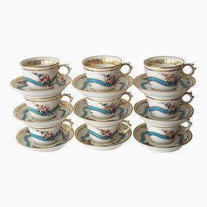 Tazas de té y platillos Old Paris antiguos de porcelana. Juego de 9