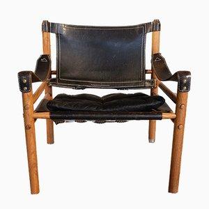 Modell Sirocco Safari Stuhl aus schwarzem Leder von Arne Norell, 1960er
