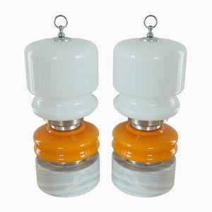 Lámparas de mesa vintage de vidrio naranja y blanco con pedestal de piedra. Juego de 2