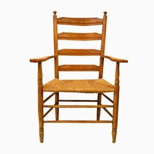 Karmin Armlehnstuhl aus Eichenholz, 1950er