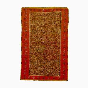Tappeto vintage color zafferano e rosso