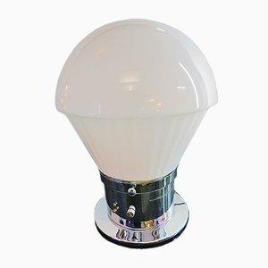 Lámpara de plexiglás con base de metal cromado que cambia de color