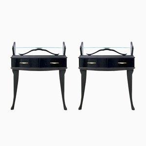 Mesitas de noche de madera lacada en negro con superficies de vidrio, años 50. Juego de 2
