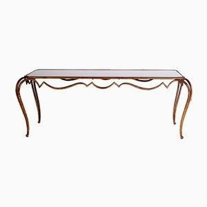 Mesa de centro vintage de hierro forjado dorado y vidrio opalino negro de René Drouet