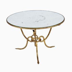 Tavolo Hollywood Regency in ferro dorato con ripiano in vetro specchiato di René Drouet