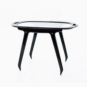 Mesa de centro italiana de vidrio y madera negra de Cesare Lacca, años 50