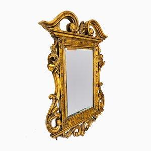 Specchio antico con cornice in legno intagliato