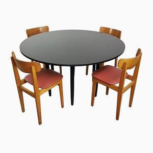 Mesa vintage redonda y cuatro sillas , años 60