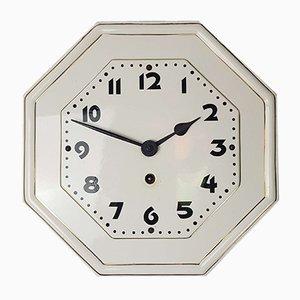 Reloj de pared modernista octogonal de porcelana con borde dorado