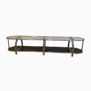Mesa de centro vintage de cuatro piezas de metal cromado y vidrio