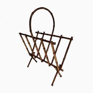 Revistero de metal dorado y bambú artificial, años 60
