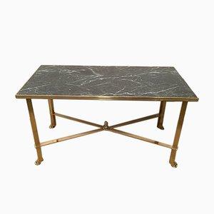 Mesa de centro de latón con patas de garra y tablero de mármol sintético, años 40