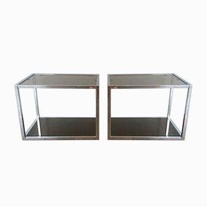 Mesas auxiliares vintage de cromado y cristal ahumado. Juego de 2