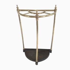 Paragüero antiguo de latón y hierro fundido
