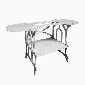 Mesa auxiliar vintage de hierro fundido