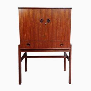 Mueble bar de teca con espejo, estante de vidrio y luz de Turnidge Furniture, años 60