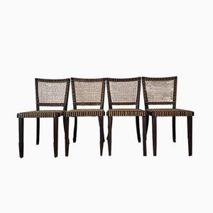 Tschechische vintage Holz & Geflecht Stühle von Jan Vanek für Moderniho Bydleni, 4er Set