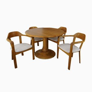 Mesa redonda con 4 sillas de roble a juego, años 80