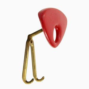 Appendiabiti in plastica rossa e ottone, anni '50