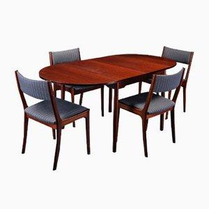 Mesa de comedor danesa vintage y cuatro sillas de caoba