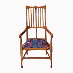 Poltrona Arts & Crafts in legno e stoffa