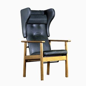 Wingback Armchair in Black Leather, 1970s