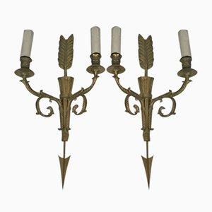 Apliques altos de bronce con flecha y cabezas de águila, años 20. Juego de 2