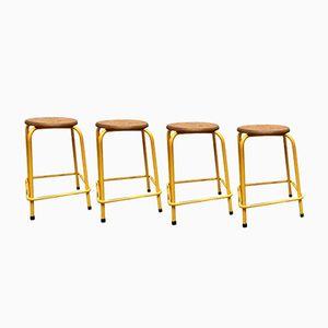 Sgabelli impilabili vintage in metallo giallo, set di 4