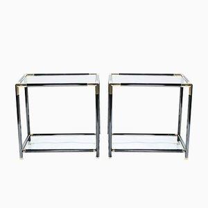 Mesas auxiliares de vidrio y latón, años 70. Juego de 2