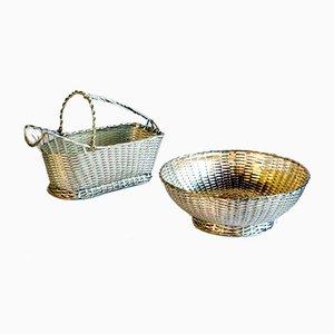 Portabottiglia e cesto in argento di Lino Sabattini per Christofle