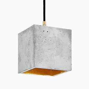 Lámpara colgante [B1] cúbica de hormigón natural y dorado de Stefan Gant para GANTlights