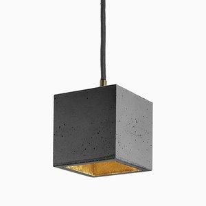 Lámpara colgante [B6] cúbica de hormigón oscuro y dorado de Stefan Gant para GANTlights