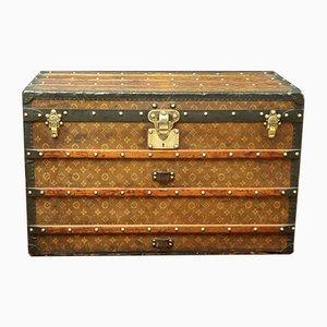 Baúl de viaje antiguo de lona tejida con monograma de Louis Vuitton, década de 1900