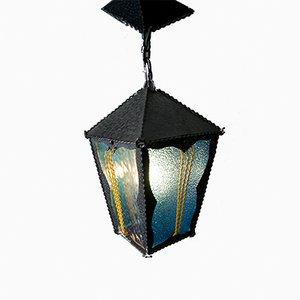 Lampada a sospensione a forma di lanterna in ferro battuto e vetro colorato, anni '50