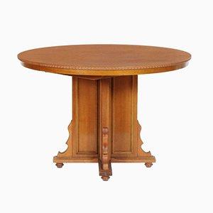 Tavolo rotondo allungabile e impiallacciato in legno di noce, Italia