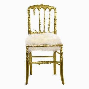 Silla Emporium chapada en oro con asiento de piel de Covet Paris