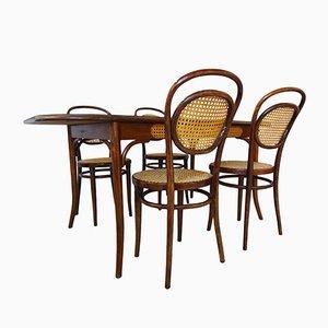 Tavolo da pranzo e sedie nr. 11 antiche di Michael Thonet per ZPM Radomsko, anni '10