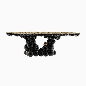 Mesa de comedor Newton en negro y dorado de Covet Paris