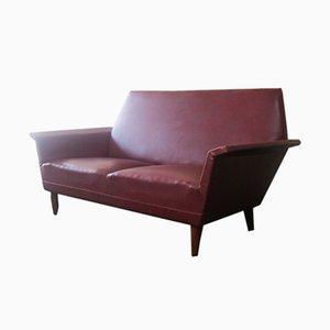 Dänisches burgunderfarbenes Vinyl Sofa, 1960er