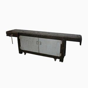 Antiker industrieller Werktisch auf Rädern