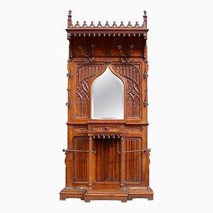 Mobile da ingresso neogotico in legno di noce intagliato, fine XIX secolo