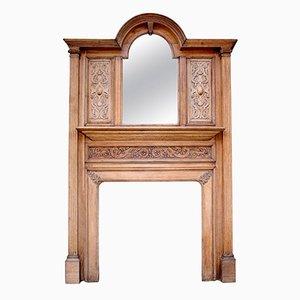 Cornice da camino antica in legno di quercia intagliato con specchio smussato, inizio XX secolo