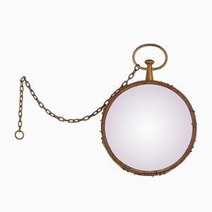 Espejo redondo de metal dorado, años 50