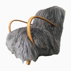 Sillón de madera curvada y piel de oveja de Jindřich Halabala, años 50