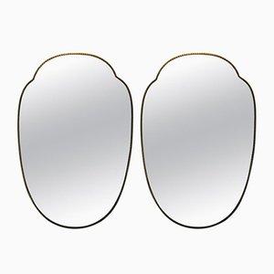 Espejos en forma de escudo de latón, años 50. Juego de 2