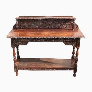 Consolle in legno di quercia scuro intagliato, inizio XX secolo