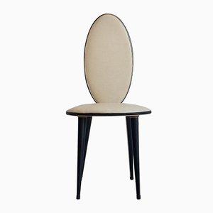 Sedia in similpelle color crema e nera di Umberto Mascagni, anni '50